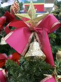 Christmas Star and Red Bow. A Christmas Star with a bell under it and a red bow on the top of an Xmas Tree Royalty Free Stock Photos