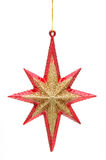 Christmas star in red and golden Stock Images