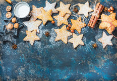 Christmas star shaped cookies with baking molds and spices Stock Photography