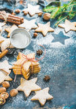 Christmas star shaped cookies with spices and fir-tree branch Royalty Free Stock Photography