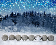 Christmas star and silver balls isolated on forest background. Silver star and christmas balls.Christmas decoration with snow and star isolated on forest royalty free stock photo