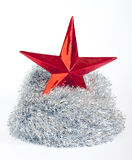 Christmas star and silver tinsel on white Stock Photos