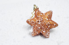 Christmas star on the snow Royalty Free Stock Photography