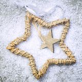 Christmas star on the snow and grey background Royalty Free Stock Photo