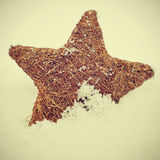 Christmas star on the snow with a retro effect Royalty Free Stock Image