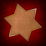 Christmas star and snowflakes. On red background Royalty Free Stock Photos