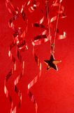 Christmas star and streamers Royalty Free Stock Image