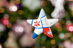 Christmas star with tree on background Royalty Free Stock Image