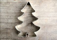 Christmas star and tree. Baking mold on wooden background Stock Photo