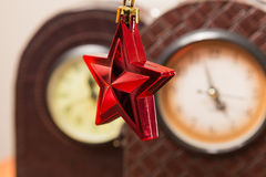 Christmas star and Watches. View of a christmas star hanging in front of some old watches Stock Photography