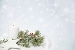 Christmas star and white candle Stock Images