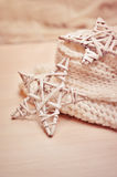 Christmas star on wicker background knitted Stock Photography
