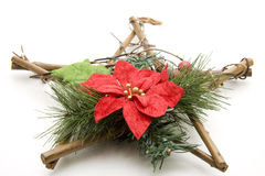 Christmas star of wood. With flower Stock Images