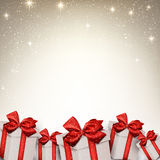 Christmas starry background with gift boxes. Royalty Free Stock Photography