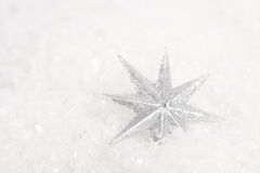 Christmas stars. Beautiful christmas stars on fake white snow Stock Photo