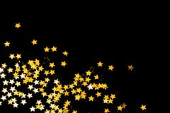 Christmas stars. Golden Christmas stars frame on black background, room for text royalty free stock photography