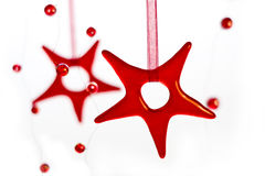 Christmas Stars. Red Glass Stars And Little balls Christmas Composition Stock Photos