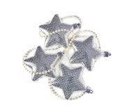 Christmas stars. Silver christmas  stars ornaments close up Royalty Free Stock Photos
