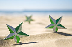 Christmas stars on beach Stock Images
