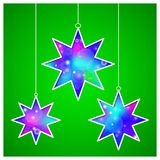 Christmas stars cut the paper. Bright abstract glowing background. Greeting card, invitation. Vector illustration. Eps 10 Stock Image