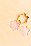 Christmas stars cutted out of dough Royalty Free Stock Photography