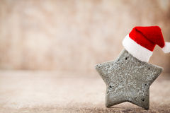 Christmas stars decoration with santa hat. Vintages background. Royalty Free Stock Photo