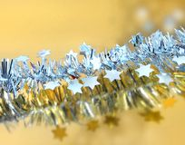 Christmas stars feeling. Christmas silver stars on golden reflective background royalty free stock photos