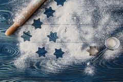 Christmas stars on flour background with copy space. White flour Stock Photos