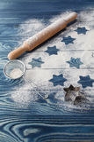 Christmas stars on flour background with copy space. White flour Stock Images