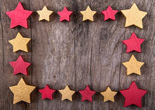 Christmas stars frame border on wood Stock Photo