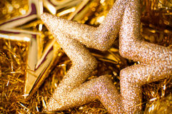Christmas stars. Gold Christmas stars with glitter Stock Images