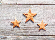 Christmas stars on grungy wood Royalty Free Stock Photos
