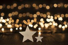Christmas stars on old wooden floor, bokeh lights. Christmas decoration on old wooden floor royalty free stock photo