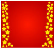 Christmas stars. On a red background Royalty Free Stock Photo