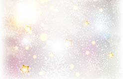 Christmas stars and snowflake background. Softly textured Christmas winter background with snowfall, snowflakes, blurry light dots and various light effects Stock Images