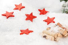 Christmas Stars. Some XMas Stars a lying in a snowy landscape Stock Photos