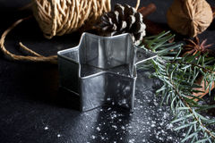 Christmas background. Christmas stars and spices on black stone background Stock Image