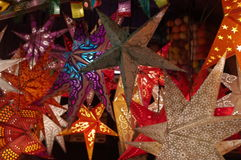 Christmas Stars. Star shaped Christmas lighting decorations hanging at a market stall at a German Christmas Market Royalty Free Stock Photography