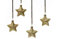 Christmas stars on white. Shiny christmas stars hanging on white background Stock Photography