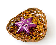 Christmas stars in wicker vase Royalty Free Stock Photo