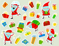 Christmas stickers with cute Santa Clause and gift boxes. Winter Royalty Free Stock Photos