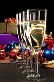 Christmas Still. Four glasses of champagne and some presents and christmas balls royalty free stock images