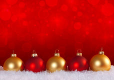 Christmas Still Life. Gold and red Christmas balls in snow Royalty Free Stock Image