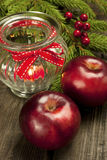 Christmas still life with apples and candle holder Stock Photo