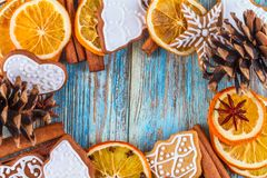 Christmas still life background with gingerbread cookies in decoration frame from festive ingredients. On wooden boards Royalty Free Stock Photography
