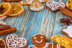 Christmas still life background with gingerbread cookies in decoration frame from festive ingredients. On wooden boards Stock Photos