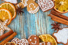 Christmas still life background with gingerbread cookies in decoration frame from festive ingredients. On wooden boards Stock Photography