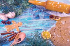 Christmas still life background with gingerbread cookies in decoration frame from ingredient for baking. On wooden boards Royalty Free Stock Photos