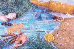 Christmas still life background with gingerbread cookies in decoration frame from ingredient for baking. On wooden boards Stock Images