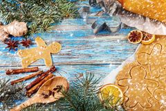 Christmas still life background with gingerbread cookies in decoration frame from ingredient for baking. On wooden boards Stock Photos